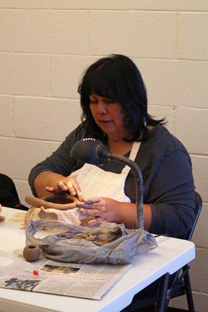 Photo of Candelaria Suazo working.