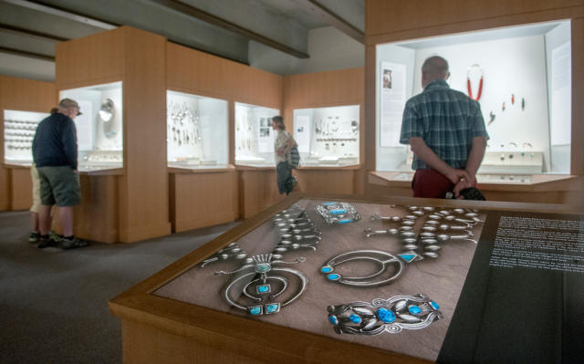 People look at Native American jewelry on display in the Martha Hopkins Struever Gallery at the Wheelwright Museum in Santa Fe. (Eddie Moore/Albuquerque Journal)