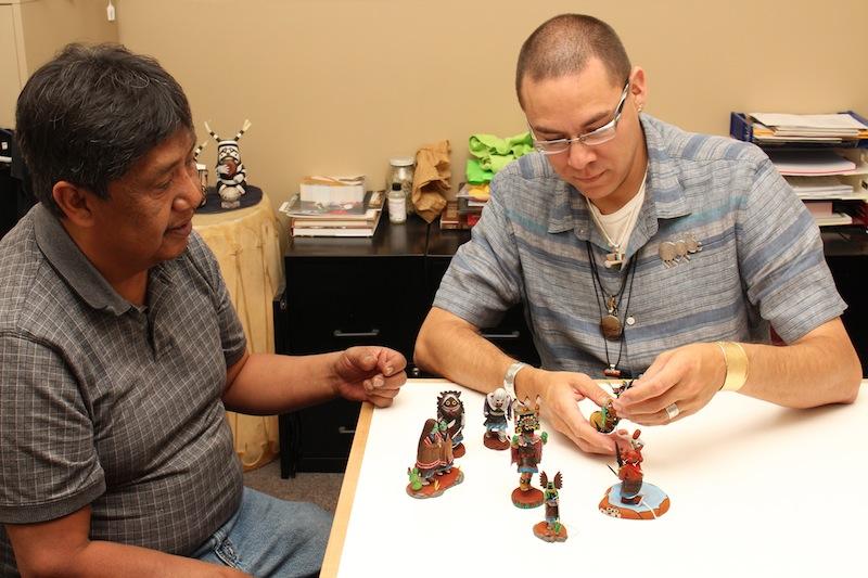Timothy Talawepi (Hopi) with Ken Williams as he examines a katsina.