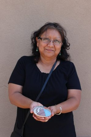 Photo of Sharon Lewis with a Pottery Piece